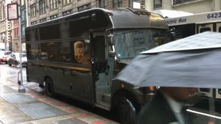 UPS delivery vehicle on side walk of New York City streets