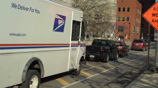 USPS delivery truck parked downtown St Louis handheld shot 4k