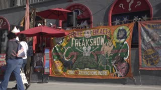 Venice Beach Freak show front of building establishing shot 4k