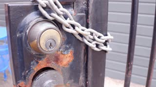 View of gate lock close up hand held 4k