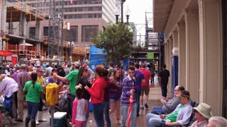 Walking down St Charles sidewalk during Mid City Parade 4k