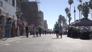 Walkway with pedestrians on Venice Beach California strip 4k