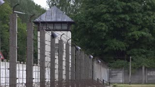Watch tower at old prison yard with barbwire fence 4k