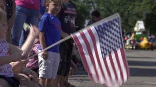 Waving American Flags along 4th of July parade route 4k
