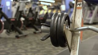 Weights on gym equipment bar 4k
