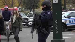 Woman police officer in NYPD standing guard at Macys Parade 4k