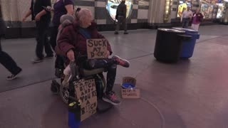 Woman with obscenity written on sign in downtown Las Vegas 4k