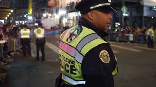 Young African American New Orleans Police officer at Hermes Parade 4k
