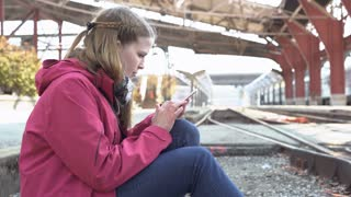 Young Female Sending Messages On Cell Phone At Railroad Track 4 K