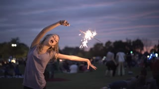 Young girl dancing with sparkler