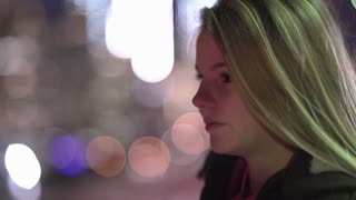 Young Girl Looking Into Distance With City Lights In Background 4 K 2