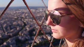 Young girl with sunglasses overlooking city from high above 4k