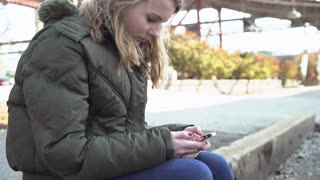 Young teen girl sending text messages on cell phone 4k