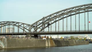 View from boat going by train bridge in Frankfurt Germany 4k