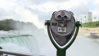 Viewing telescope at Niagara Falls with water in background