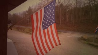 Vintage american flag waving in wind at store