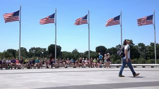 Visitors at base of Washington Monument with US Flags 4k