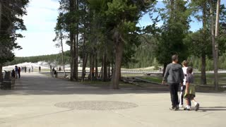 Visitors at Old Faithful in Yellowstone