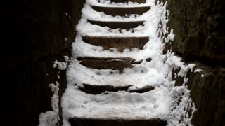 Walking down steps covered in snow