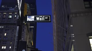 Wall Street sign in downtown New York City 4k