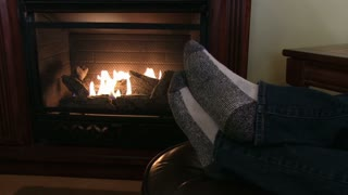 Warm feet in front of fireplace