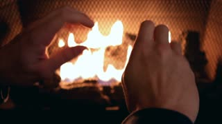 Warming hands in front of fire