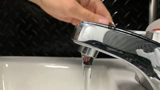 Washing hands in public bathroom sink 4k