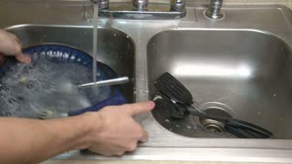 Washing Plate in Kitchen Sink