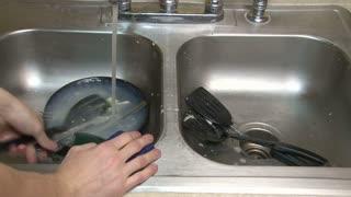 Washing Utensils in Kitchen Sink