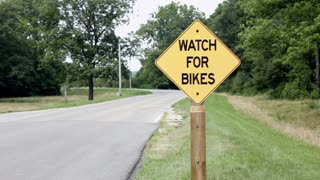 Watch for Bikes sign on side of road