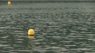 Water buoy floating in lake