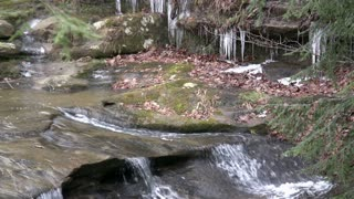 Water flowing down Mountain with Ice in Background