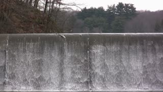 Water flowing over Dam Close Up