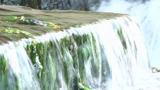 Water flowing over ledge with moss