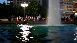 Water fountain in city at night