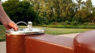 Water fountain in park dolly shot
