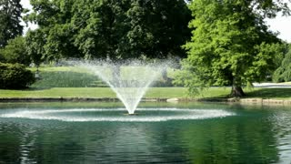 Water Fountain in Park Pond