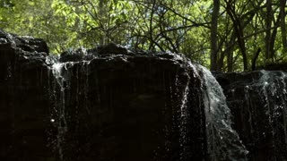 Water over waterfall edge in super slow motion 720p