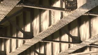Water reflections under bridge