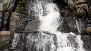 Water running down rock face in mountain 4k