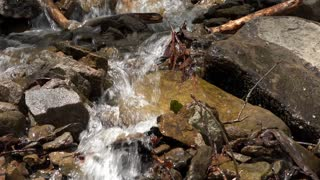 Water rushing down rocks in creek 4k