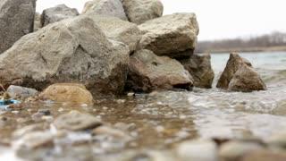Water splashing on shore low view