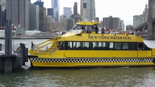 Water Taxi dropping off passengers at DUMBO in New York City 4k