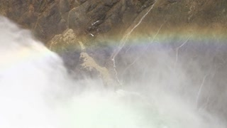 Waterfall mist creates rainbow slow motion