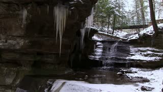Waterfall underneath path in winter