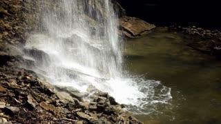 Waterfall water hitting rocks slow shutter