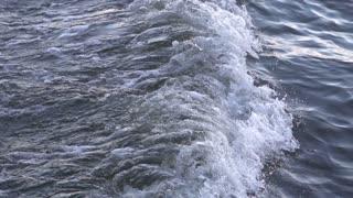 Waves from boat splashing close up