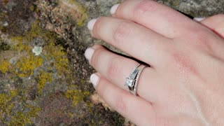 Wedding ring sparkling in sun