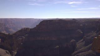 West rim of Grand Canyon establishing pan shot to people on edge 4k