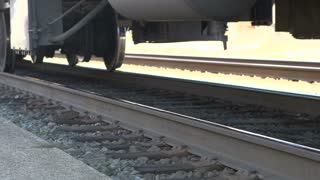 Wheels of train as it passes on track